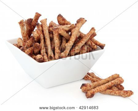 Twiglet snacks in a porcelain square dish over white background.
