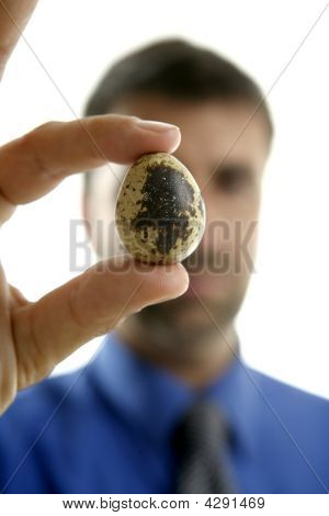 Businessman Holding A Quail Fragile Egg