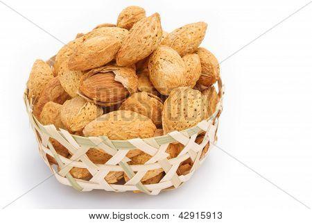 Almond Nuts In Weaven Basket On White