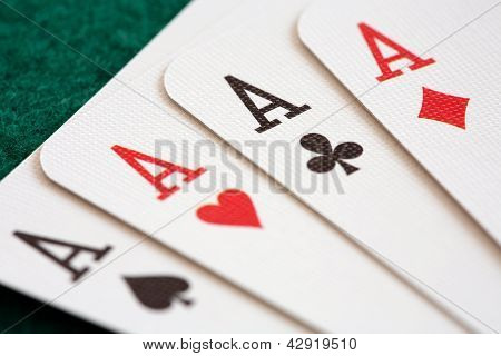 Close-up Of Four Playing Cards Showing Aces.