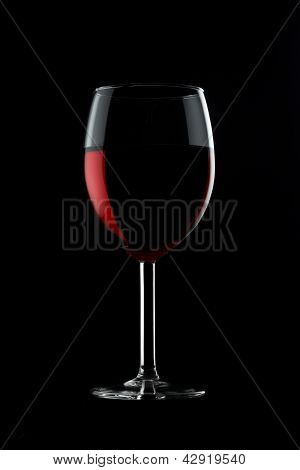 One Glassed Of Red Wine Isolated On Black Background