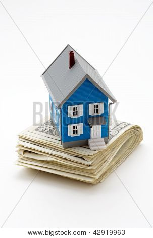 Model House On Dollar Bills Isolated On White Background