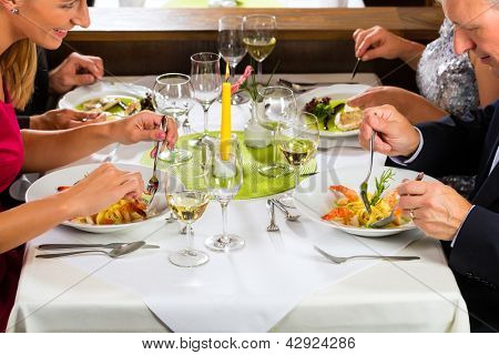 Family, mother and father with adult children and daughter or son in law �¢??fine dining in nice restaurant or hotel