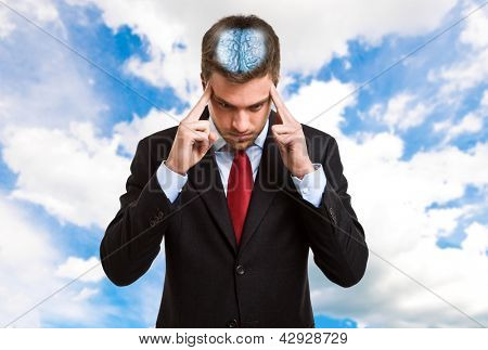 Concentrated businessman trying to focus his mind