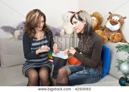 Friends Investigating Bag Contents