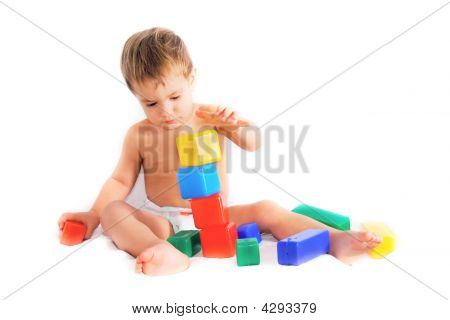 Child Playing With Bulding Blocks