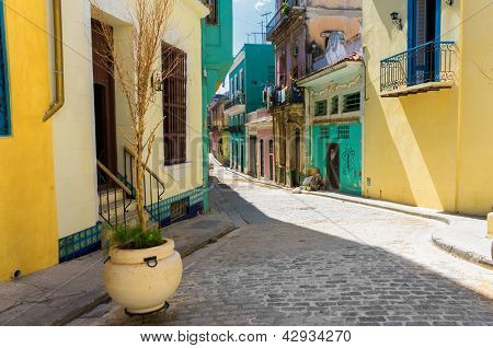 Narrow street sidelined by colorful buildings in Old Havana