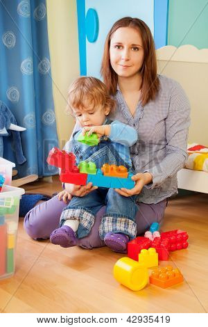 Mother And Kid - Playing With Blocks