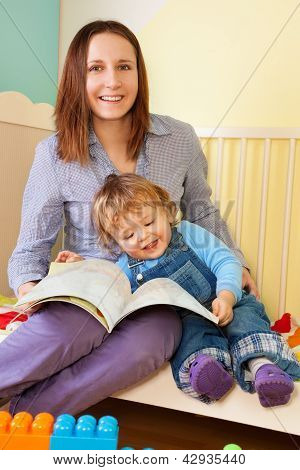 Mother And Toddler Reading A Book