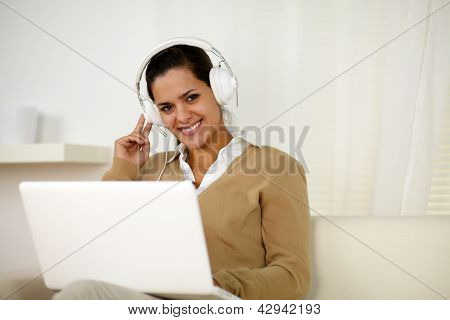Smiling Young Woman With Headphone Looking At You
