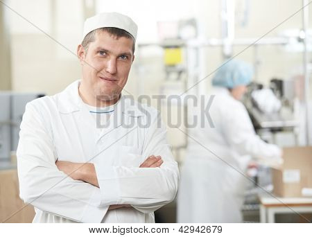 Pharmaceutical male worker at industrial pharmacy manufacture factory