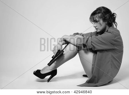 Strained Woman With A Handgun
