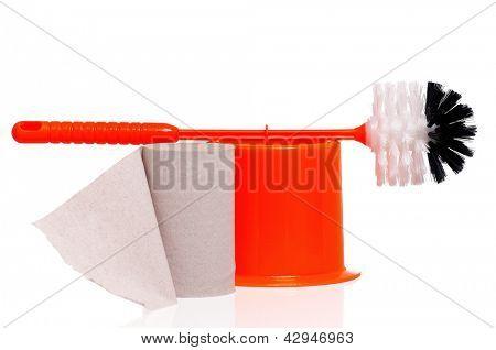 Plastic orange toilet brush and paper isolated on white background