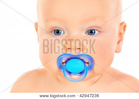 Close-up portrait of cute small baby holding his dummy. Isolated over white.