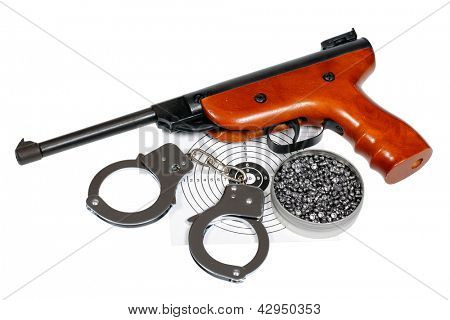 Target shooting equipment with handcuffs isolated over white, clipping path.