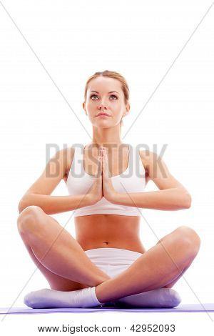 woman practicing yoga in lotus pose