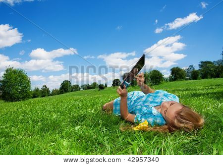 Student Enjoying Internet  In Park