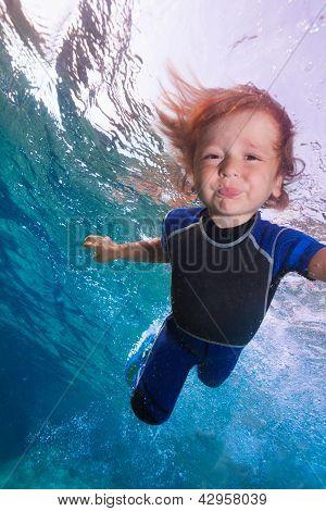 Funny Little Boy Underwater