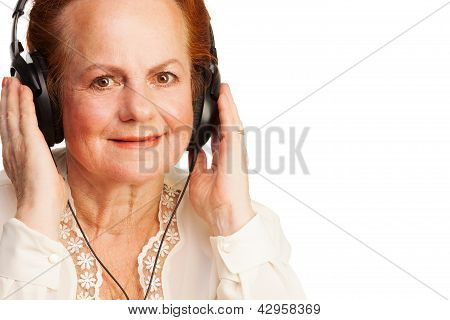 Positive Retired Woman Listening To Music