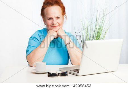 Confident Senior Woman With Laptop