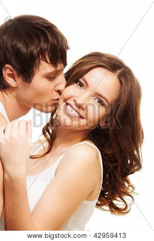 Young Man Kissing Girl