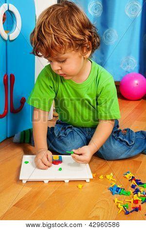 Little Boy Solving Puzzle