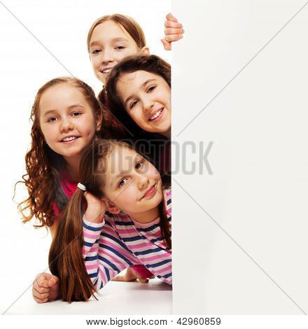Group Of Girls Behind Advertising Board