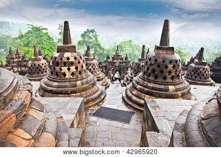 Stupa statue  from Borobudur at sunrice on Java in Indonesia.