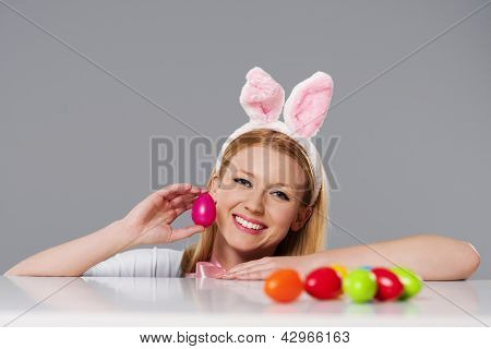 Blonde woman with bunny ears and easter eggs
