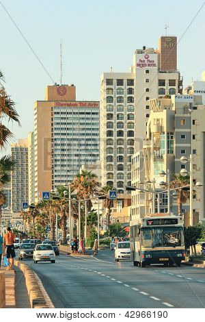 TEL AVIV - JULY 01: Street with cars and bus along seafront and hotels which are among largest and most popular resorts on Mediterranean sea for tourists visiting in Tel Aviv, Israel on July 01, 2009.