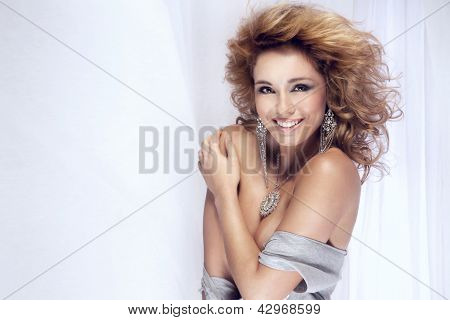 Portrait Of Happy Smiling Blonde Girl Looking At Camera