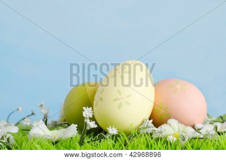 Easter Eggs On Grass With Flowers