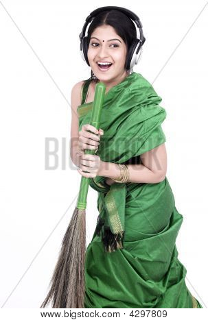 Woman Of Indian Origin Holding A Broom And Singing