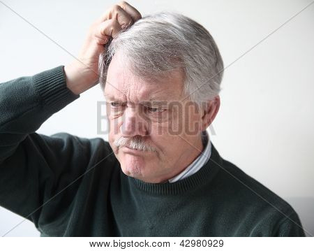 older man is frustrated