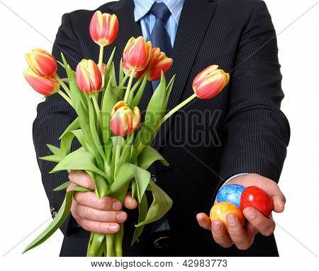 Man In Suit And Tie Gives Easter Eggs And Tulips