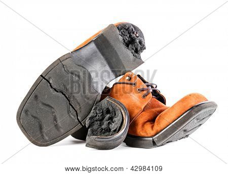 Old broken shoes with cracked sole, isolated on white