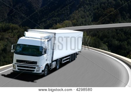 White Semi Truck In Mountain