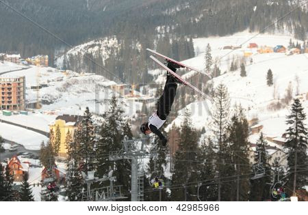 BUKOVEL, UKRAINE - FEBRUARY 23: Denis Osipau, Belarus performs aerial skiing during Freestyle Ski World Cup in Bukovel, Ukraine on February 23, 2013