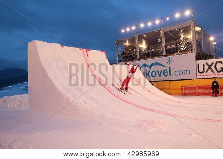 BUKOVEL, UKRAINE - FEBRUARY 23: Sicun Xu, China performs aerial skiing during Freestyle Ski World Cup in Bukovel, Ukraine on February 23, 2013