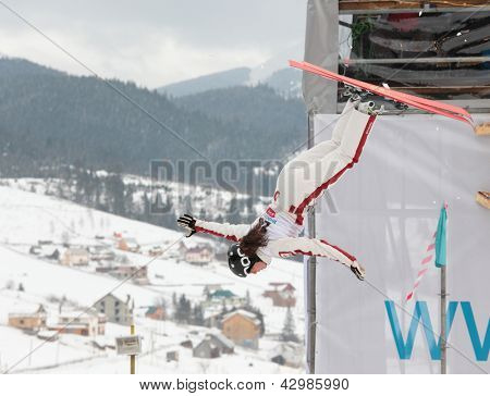 BUKOVEL, UKRAINE - FEBRUARY 23: Sabrina Guerin, Canada performs aerial skiing during Freestyle Ski World Cup in Bukovel, Ukraine on February 23, 2013