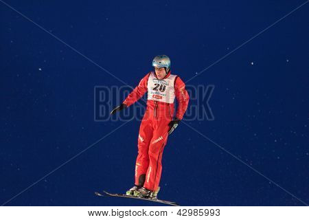BUKOVEL, UKRAINE - FEBRUARY 23: Andreas Isoz, Switzerland performs aerial skiing during Freestyle Ski World Cup in Bukovel, Ukraine on February 23, 2013