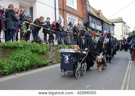 HASTINGS, ENGLAND - MAY 7: Morris dancers parade through the Old Town during the annual Jack In The Green festival on May 7, 2012 at Hastings, East Sussex. The event marks the May Day public holiday.