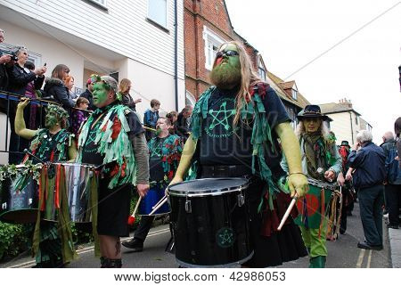HASTINGS, ENGLAND - MAY 7: Drummers parade through the Old Town during the annual Jack In The Green festival on May 7, 2012 at Hastings, East Sussex. The event marks the May Day public holiday.