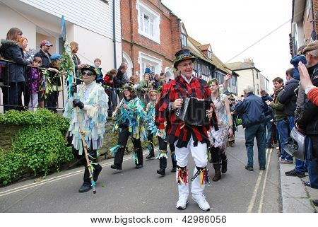 HASTINGS, ENGLAND - MAY 7: Musicians  parade through the Old Town during the annual Jack In The Green festival on May 7, 2012 at Hastings, East Sussex. The event marks the May Day public holiday.
