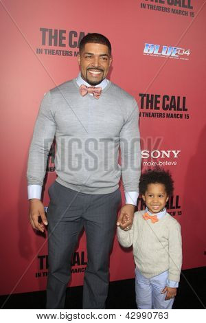LOS ANGELES - MAR 5:  David Otunga, David Otunga Jr. arrives at