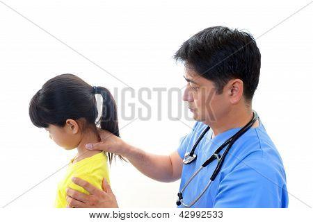 Doctor examining a girl