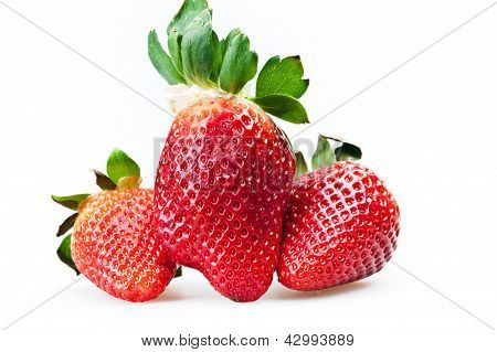 few ripe strawberries isolated on white