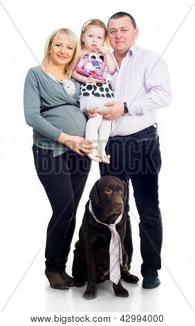 Family with black retriver in studio on a white