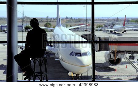 Black Man Silhouette On The Airport Hall