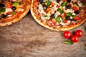 picture of crust  - Delicious italian pizza served on wooden table - JPG
